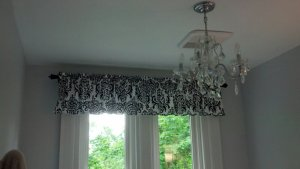 Black rod and black and white valance in my daughter's bathroom.